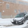 Another storm hit the north central region on Tuesday less then a week after the last storm that dropped 18+ inches on the region. A tow truck driver works on moving this car that slid into a telephone pole on Crawford Street in Leominster in front of  exhibit Technology during the storm. SENTINEL & ENTERPRISE/JOHN LOVE