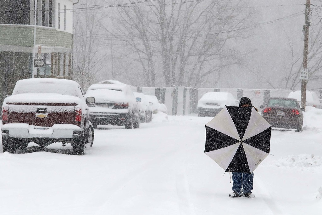 . Another storm hit the north central region on Tuesday less then a week after the last storm that dropped 18+ inches on the region. Raul Rosando uses his umbrella to keep the wind off of him so he could smoke as he made his way through the storm in Fitchburg. SENTINEL & ENTERPRISE/JOHN LOVE