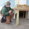 While trying to find a suitable alternative for the ramp they could not build for Navy Veteran Seaman Donald Denoncourt's, 77, at his home in the Meadowbrook Acres mobile home park on Central Street in Leominster they found another resident in the park that had a lift that she no longer needed. Firefighter Jeremy Murphy works on the new porch they need for the donated lift. SENTINEL & ENTERPRISE/JOHN LOVE
