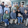 Fourteen of the 20 or so Leominster firefighters that came to volunteer to build Navy Veteran Seaman Donald Denoncourt, 77, a handicap ramp at his home in Meadowbrook Acres on Monday morning. They were told due to regulations at the mobile home park that they could not build the ramp they had planned to build. From left in front is Firefighter Kimberly Bonney, Lt. Ryan Young, Home owner Navy Veteran Seaman Donald Denoncourt with his dog Bella and firefighter Jonathan Williams. Standing is, from left, Lt. Craig Long, Firefighter Sean Gray, Firefighter Erin Bailey, retired Firefighter Mark Matley, Lt. Jonathan Campagna, Firefighters Vincent Alia, Ben Brideau, Tim Comeau, Eric Arsenault, Dave Fagone and Lt. Shayne Newton.  SENTINEL & ENTERPRISE/JOHN LOVE