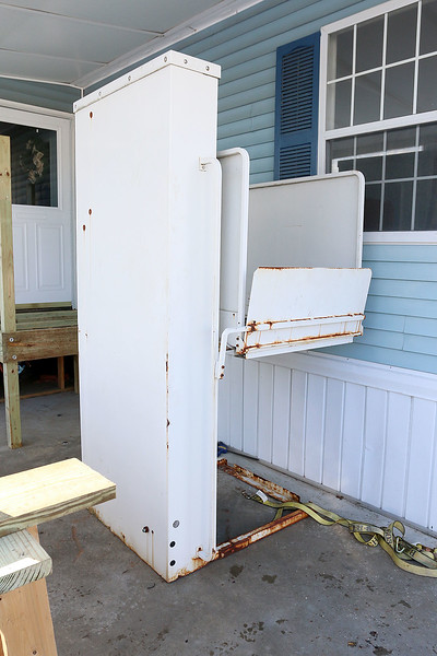 While trying to find a suitable alternative for the ramp they could not build for Navy Veteran Seaman Donald Denoncourt's, 77, at his home in the Meadowbrook Acres mobile home park on Central Street in Leominster they found another resident in the park that had a lift that she no longer needed. The donated lift waits for the porch to be finished so it could be put into place. SENTINEL & ENTERPRISE/JOHN LOVE