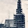 An0056 <br /> Toren van de Ned. Herv. kerk, gerestaureerd door de fa. De Raat. Nieuw gebinte en nieuwe zolders werden aangebracht en de toren is grotendeels met nieuwe stenen opgemetseld. De oude ingang onder de toren werd hersteld en de steunberen vernieuwd. In 1958 kwam dit werk gereed. Foto: 1957-1958.