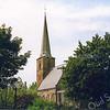 An0025 <br /> Ned.-herv. kerk, gebouwd omstreeks 1080, 13de-eeuwse toren. Grotendeels verwoest in 1574, herbouwd in 1595. De toren is gerestaureerd in 1957/58 door de firma De Raat. Het kerkgebouw is gerestaureerd in 1971/73 onder leiding van architect Van der Sterre. Het oudste tufstenen deel met romaanse ramen is in de oorspronkelijke staat teruggebracht,. Oude zij-ingang weer aangebracht. Het lage gedeelte dateert uit de 18e eeuw. Foto: eind jaren '80.