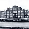 An0078 <br /> Vooraanzicht St. Bernardus, bejaardenhuis en verpleegafdeling, afgebroken in 1971. De eerste steen werd gelegd op 13 mei 1924, architect was J. Tonnaer, aannemer was C. Kiebert. De inwijding vond plaats op 4 december 1924. Links op de foto is de uitbreiding in latere jaren zichtbaar. Foto: 1969.