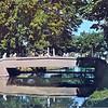 An0034 <br /> Het Oude Koningshuys met betonnen brug met sierlijk hekwerk, geflankeerd door vier leeuwen. Foto: jaren '80.