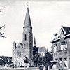 An0061 <br /> St. Pancratius. De Parklaan is inmiddels aangelegd. Het huis Zonnehof (stond links van het huis met de luifel boven de voordeur) is verdwenen en de tram is vervangen door de bus. Rechts is de kantoorboekhandel van Demmenie, later Duvak. Foto: ca. 1969.