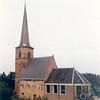An0024 <br /> Ned.-herv. kerk, gebouwd omstreeks 1080, 13de-eeuwse toren. Grotendeels verwoest in 1574, herbouwd in 1595. De toren is gerestaureerd in 1957/58 door de firma De Raat. Het kerkgebouw is gerestaureerd in 1971/73 onder leiding van architect Van der Sterre. Het oudste tufstenen deel met romaanse ramen is in de oorspronkelijke staat teruggebracht,. Oude zij-ingang weer aangebracht. Het lage gedeelte dateert uit de 18e eeuw. Foto: oktober 1992.