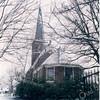 An0023 <br /> Ned.-herv. kerk, gebouwd omstreeks 1080, 13de-eeuwse toren. Grotendeels verwoest in 1574, herbouwd in 1595. De toren is gerestaureerd in 1957/58 door de firma De Raat. Het kerkgebouw is gerestaureerd in 1971/73 onder leiding van architect Van der Sterre. Het oudste tufstenen deel met romaanse ramen is in de oorspronkelijke staat teruggebracht,. Oude zij-ingang weer aangebracht. Het lage gedeelte dateert uit de 18e eeuw. Foto: oktober 1992.