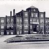 An0012<br /> Vooraanzicht van de St. Bernardus, bejaardenhuis en verpleegafdeling, afgebroken in 1971. De eerste steen werd gelegd op 13 mei 1924, architect was J. Tonnaer, aannemer was C. Kiebert. De inwijding vond plaats op 4 december 1924. Links op de foto is de uitbreiding in latere jaren zichtbaar. Foto: begin jaren '60.