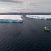 Arctic Sunrise and tabular iceberg in the Antarctic