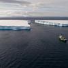 Arctic Sunrise and tabular iceberg in the Antarctic