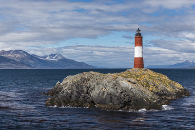 Les Eclaireurs Lighthouse. Known as the Lighthouse at the End of the World. East of Ushuaia, Argentina in the Beagle Channel, Tierra del Fuego, southern Argentina. 33 feet high; 10 feet wide at base. Commenced operations: 1920.