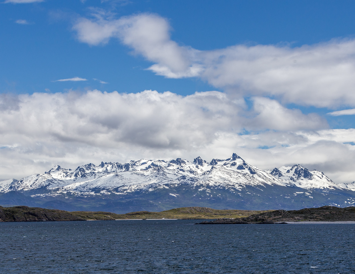 Islas de los Lobos (foreground), East of Ushuaia on the Beagle Channel, Tierra del Fuego, Argentina. In the background: Dientes de Navarino, part of the Andes mountain range on Isla Navarino, Magallanes, Chile.