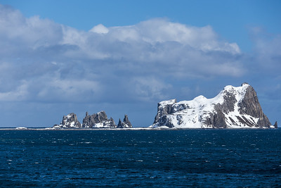 Cecilia Island is the ice-free southernmost island of the South Shetland Islands (aka Aitcho Islands) on the west side of English Strait between Greenwich Island and Robert Island. Antarctica.