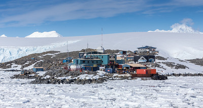 Palmer Station Antarctica, is a United States research station operated by the United States Antarctic Program (USAP) and funded by the National Science Foundation.   During our expedition, the National Geographic Explorer staff received a distress call from Palmer Station:  six U.S. scientists were unable to leave the station for Christmas leave given that the station's tender ship was unable reach the station due to excessive icebergs (see foreground) in the harbor.  National Geographic Explorer to the rescue and the six scientists were welcomed aboard for the duration of the journey.  Palmer Station is located on the coast of Paradise Bay of Anvers Island, a part of the Palmer Archipeligo.