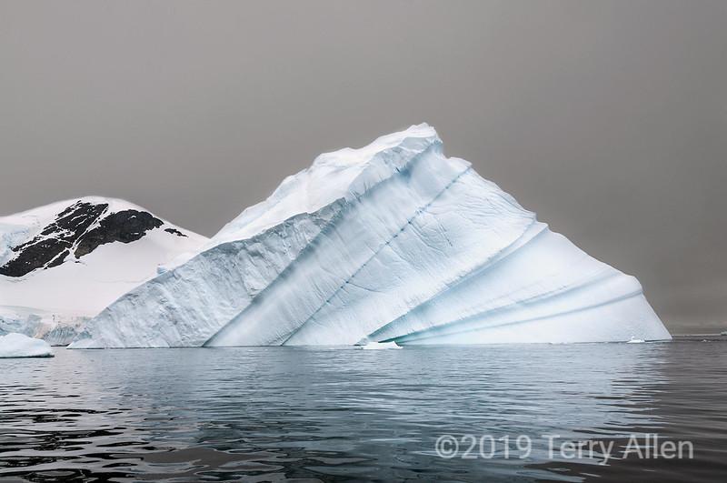 Tilted-iceberg,-Almirante-Brown,-Antarctic-Penninsula