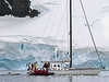 French-yacht-leaving-Paradise-Bay,-Antarctic-Peninsula
