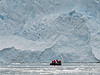 Zodiac-by-the-face-of-the-glacier,-Neko-Harbour,-Antarctic-Peninsula