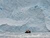 Zodiac-by-the-face-of-the-glacier,-Neko-Harbour,-Antarctic-Peninsula