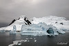 Sculptured-blue-iceberg,-Neko-Harbour,-Antarctic-Peninsula