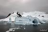 Sculptured-blue-iceberg,-Neko-Harbour,-Antarctic-Peninsula