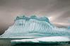 Striated-iceberg,-Couverville-Island,-Antarctic-Peninsula