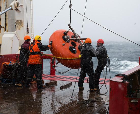 Deploying mooring sub-surface buoy
