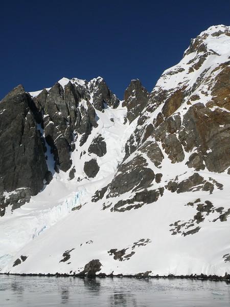 Peaks alongside the ship