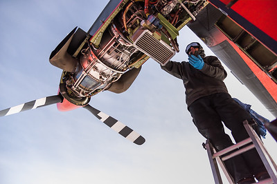 Mike Bertrand servicing a Twin Otter at Theils Depot, S85º, Antarctica