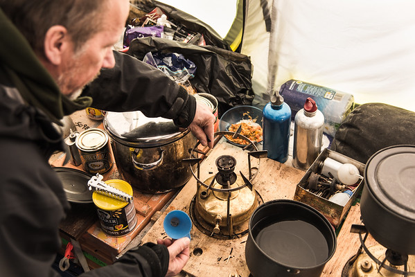Arne Oleson refueling a stove, Theils Depot, S85º, Antarctica
