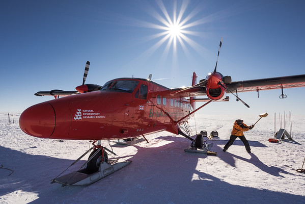 Mike Bertrand dislodging frozen skis, Theils Depot, 85º, Antarctica