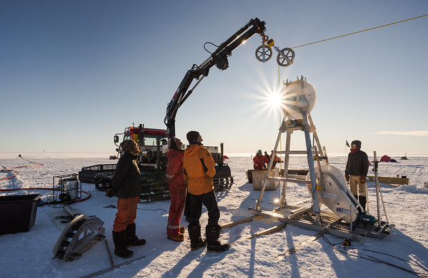 Still working under the midnight sun. Hot water ice drilling at 'Tango' site, Filcher Ice Shelf, Antarctica