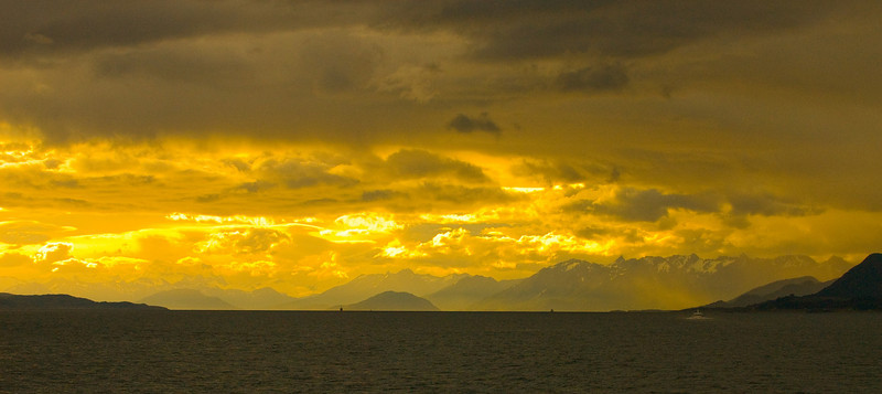 Sunset on Canal Beagle. Argentina is on the right side, Chile on the left side.