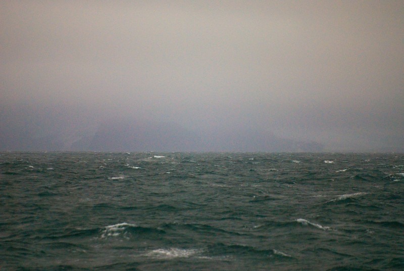 A faint view of the eastern tip of King George Island (South Shetland Islands)