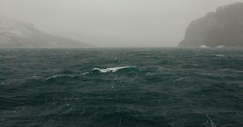 Approaching Deception Island's Neptune's Bellows during a storm