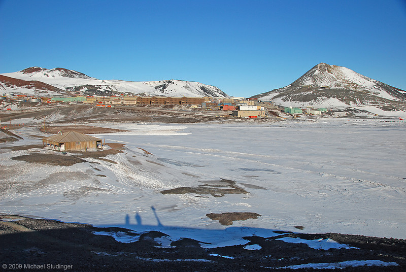 McMurdo Station with the historic Discovery Hut in the forground. The hut was built during Scott's 1901-1903 expedition. The contrast between old and new is amazing.