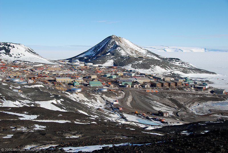 A view of McMurdo Station on Ross Island, Antarctica. McMurdo is the main logistics hub to support research for the U.S. Antarctic Program and has a bit of an Arctic mining town character. Observation Hill right behind McMurdo is nice for a stroll and great views of the Transantarctic Mountains.