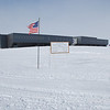 The real South Pole. The location of the actual geographic South Pole is marked by the thin aluminum pole behind the sign that is moved every year to account for the ice flow.