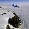 The tip of the DC-8's wing cuts across a dramatic view of Antarctica's Theron Mountains and Bailey Ice Stream.