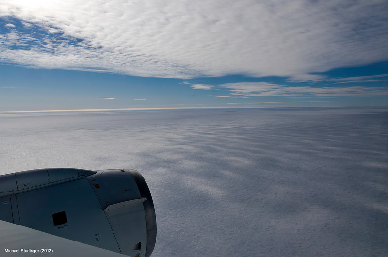 Collecting data below a layer of high clouds over Thwaites Glacier in West Antarctica with NASA's DC-8 research aircraft.