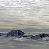 Mountains along the Hobbs Coast in Marie Byrd Land, Antarctica. The high clouds indicate deteriorating weather conditions within several hours.