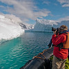 Photographing beautiful icebergs while Zodiac cruising along the Antarctic Peninsula. By Ted Cheeseman in Antarctica, Jan 2012.
