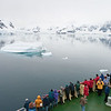Ship cruising in the beautiful scenery of the Antarctic Peninsula. By Ted Cheeseman in Antarctica, Jan 2004.