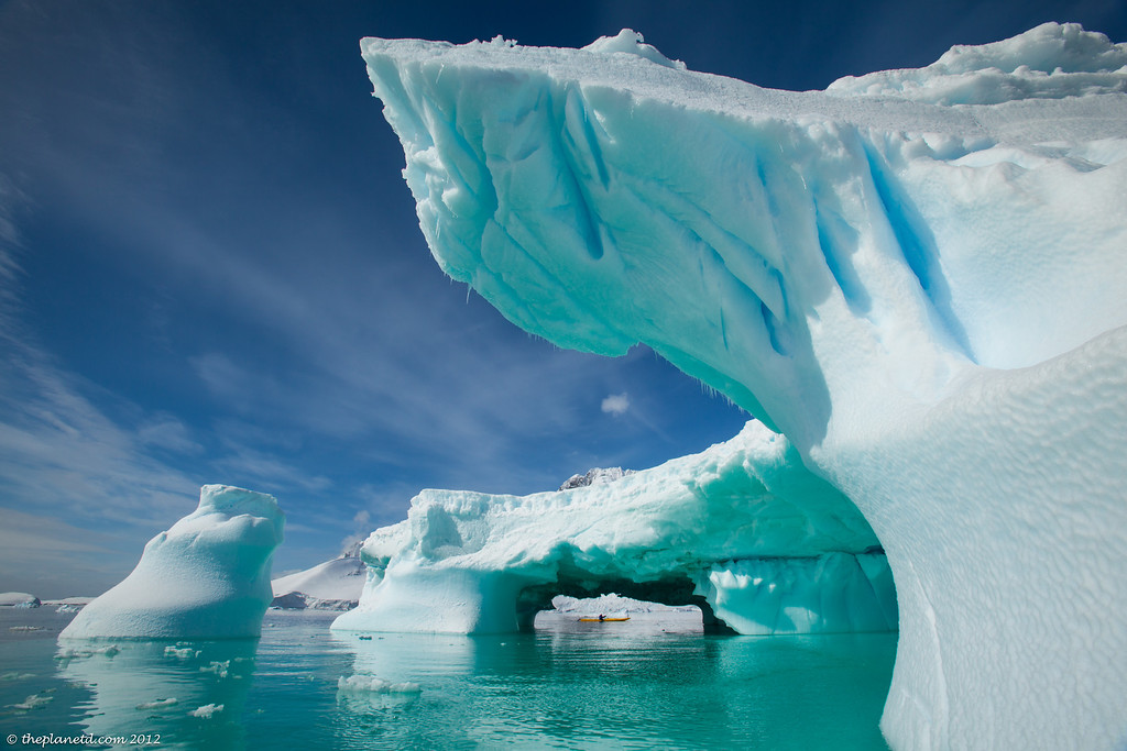 http://travelphotos.picturetheplanet.com/Antarctica/Activities/i-RmQZT6J/0/XL/Kayaking-Antarctica-10-XL.jpg