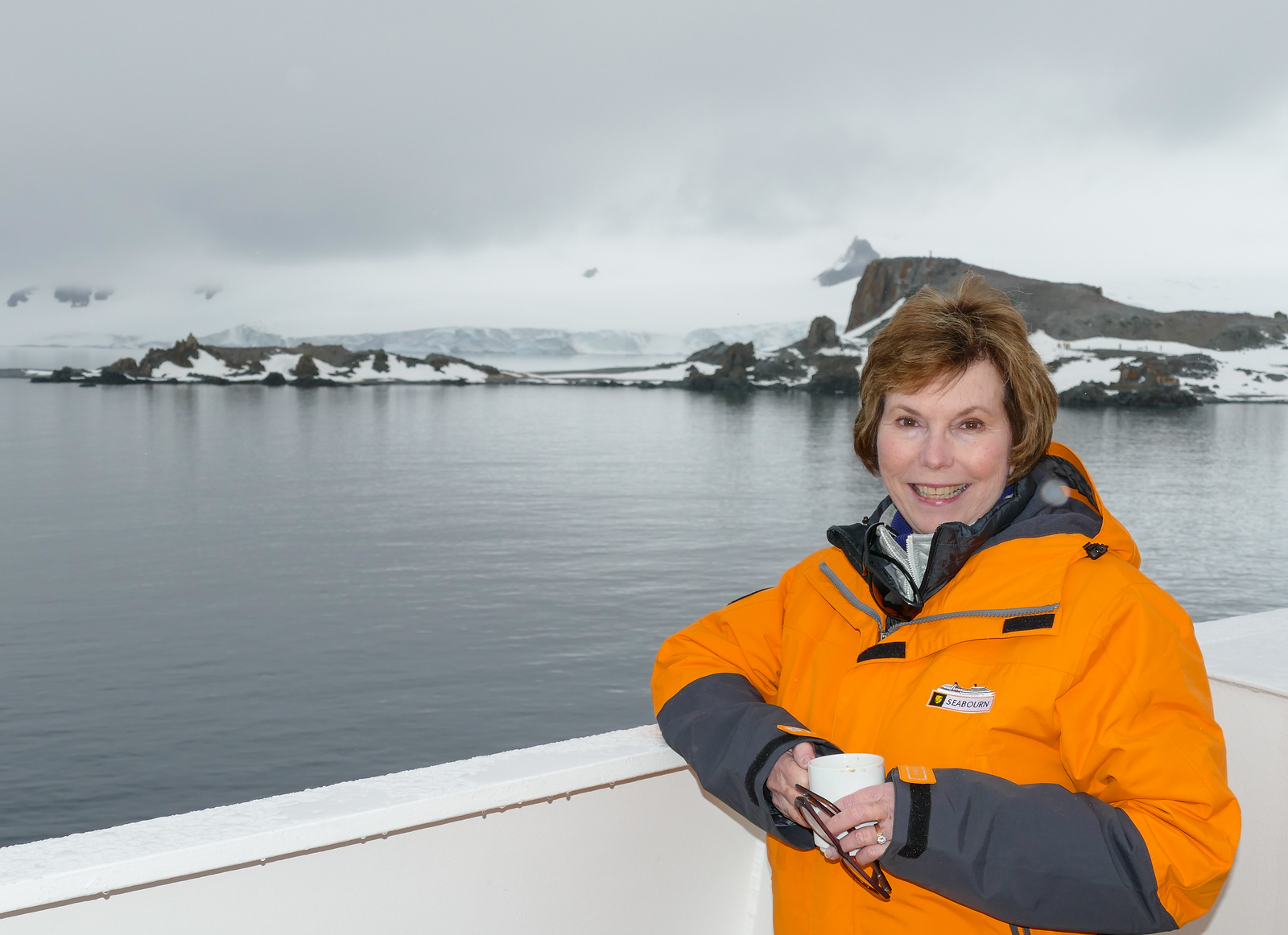 Donna Hull sips a cup of hot chocolate before going on a Seabourn excursion to Half Moon Island in Antarctica.