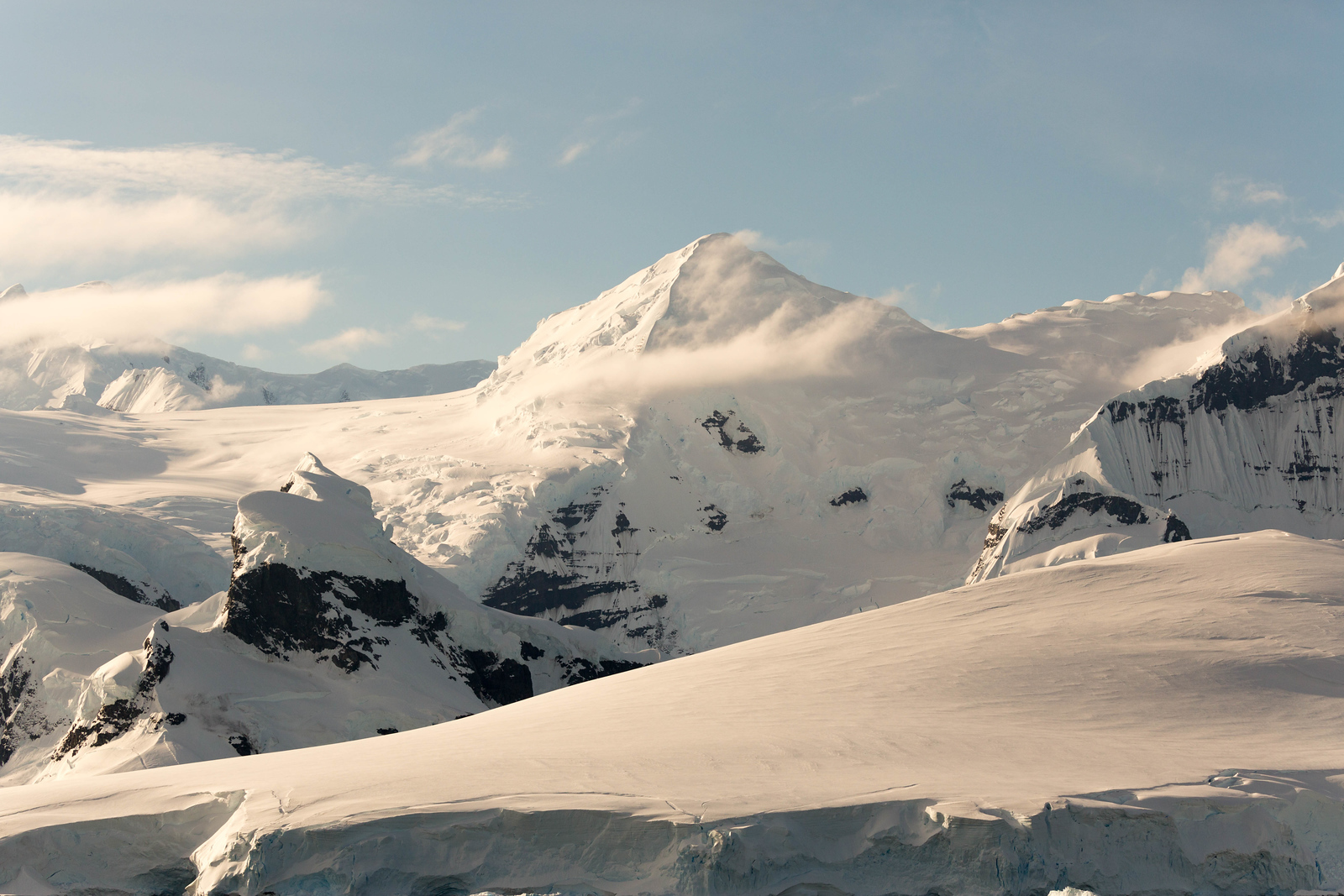 You'll see stunning mountain scenery on a cruise in Neumayer Channel. It's a beautiful part of an Antarctica cruise.