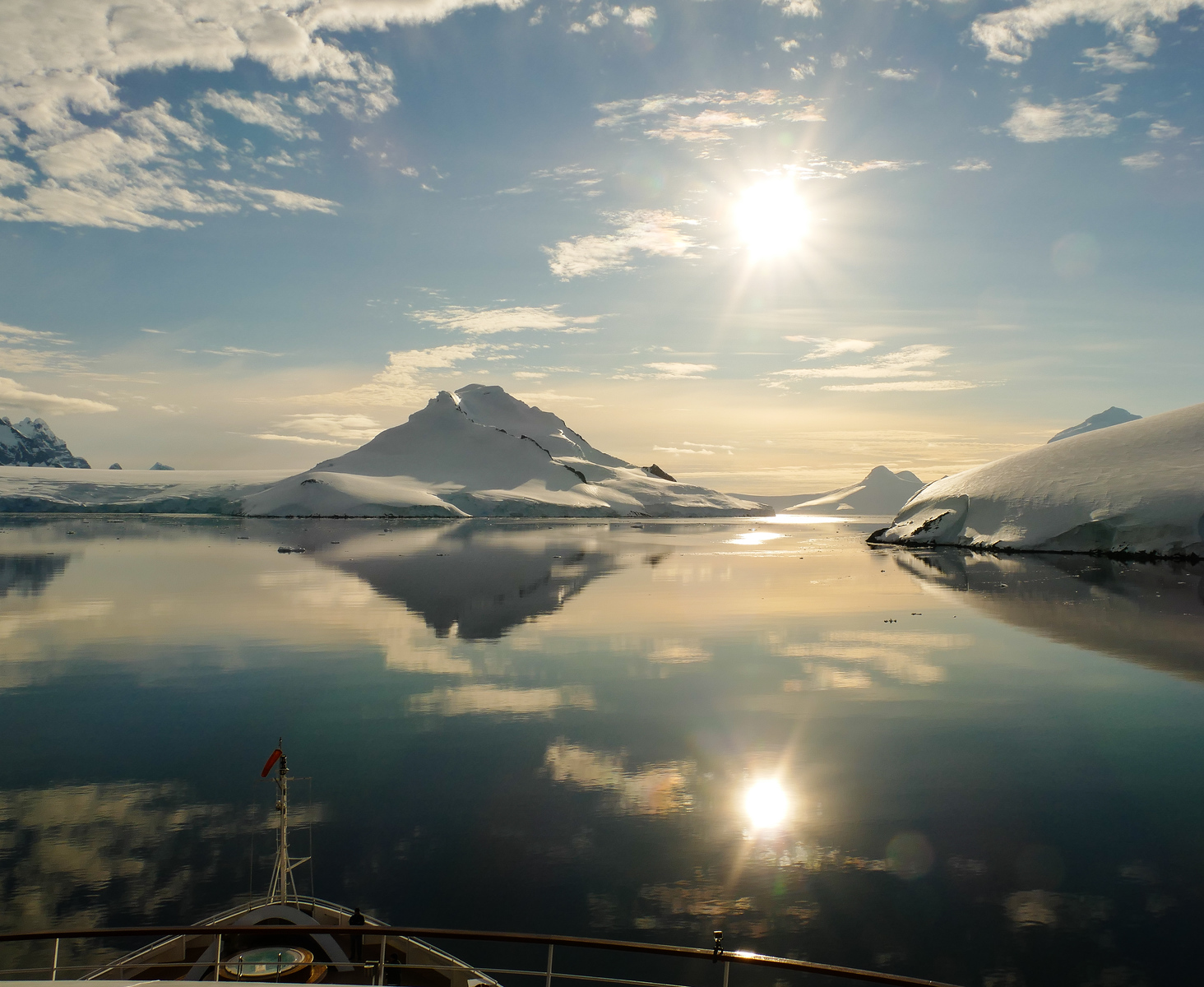 Sunlight reflects on the waters of Neumayer Channel. It's a beautiful Antarctica travel experience.