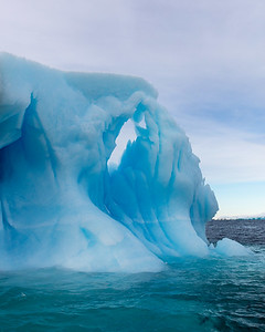 Other icebergs assume dramatic strange forms