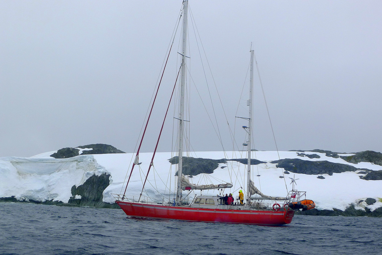 """The sailboat """"Selma Expeditions"""" nears Wordie House onWinter Island. 65˚15'S, 64˚16'W  http://www.selmaexpeditions.com/selma.php?lang=2"""