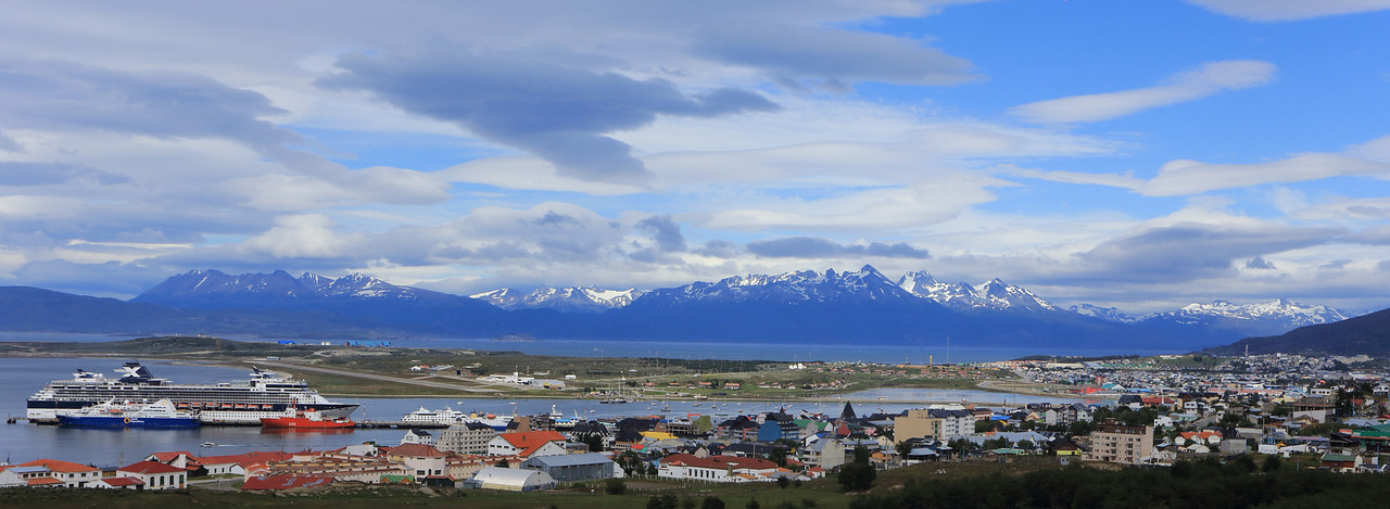 Ushuaia panorama; a large cruise ship docked, an Antarctic expedition ship by Quark is docked beside it, a good size comparison.